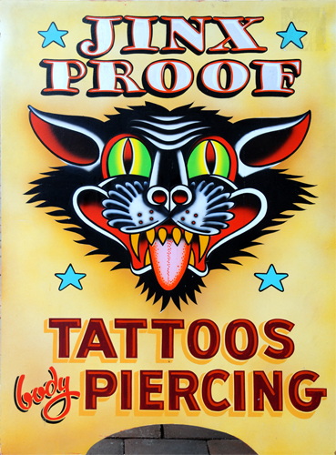 Jinx Proof Tattoos and Piercing Sign on the M Street NW Sidewalk