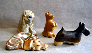 Tremar Pottery Little Dogs - 4 Dogs - Old English Sheepdog, Cairn Terrier, Cocker Spaniel, Scottish Terrier - Photo by dragonflypottery on www.ebay.com