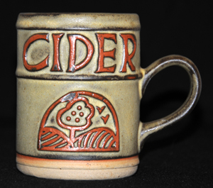 Tremar Pottery - Cider Mug - Country scene with apple tree and birds. Firing flaw visible just above tree.