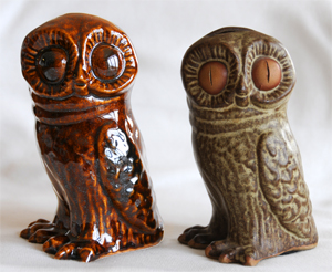 Tremar Potter Owls - This image shows the unusual brown version on the left next to the much more common owl money box/piggy bank version.