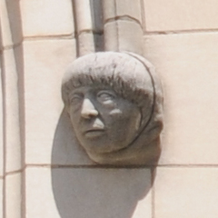 Carved Face To The Right of the Space Window