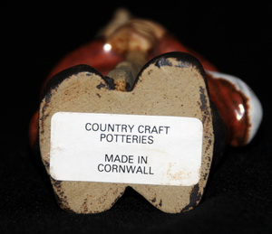 View of the Country Craft Potteries label on the bottom of the soldier figure.