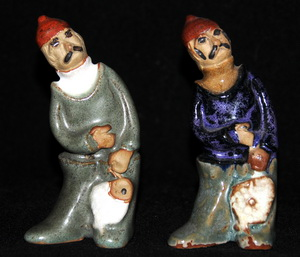 Country Craft Potteries Fisherman on the left. Tremar Pottery People Fisherman on the right.